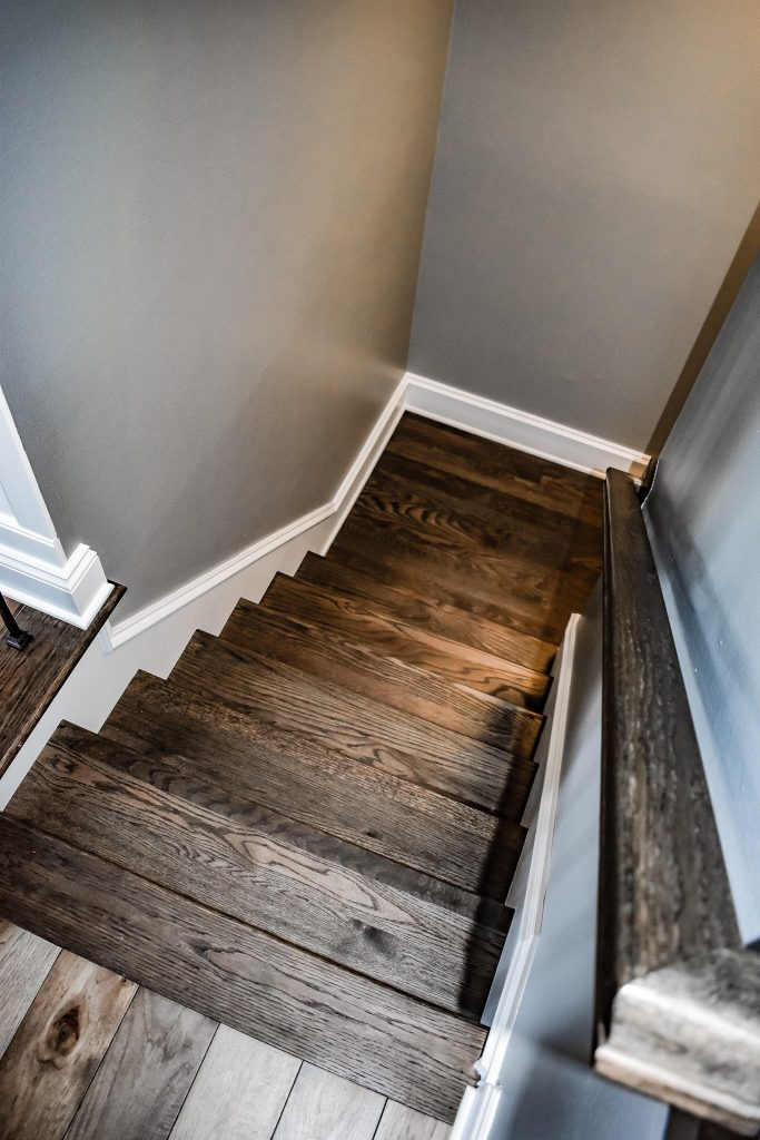 wide plank flooring on stairs